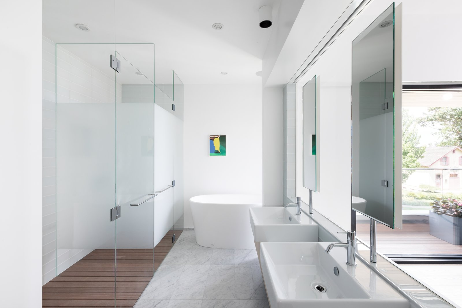 Tagged: Bath Room, Full Shower, Freestanding Tub, Wall Mount Sink, Medium Hardwood Floor, Ceiling Lighting, Recessed Lighting, and Marble Floor.  Photo 9 of 12 in Wrapped in Galvanized Steel, 'Cube House' in Vancouver Asks $12.8M