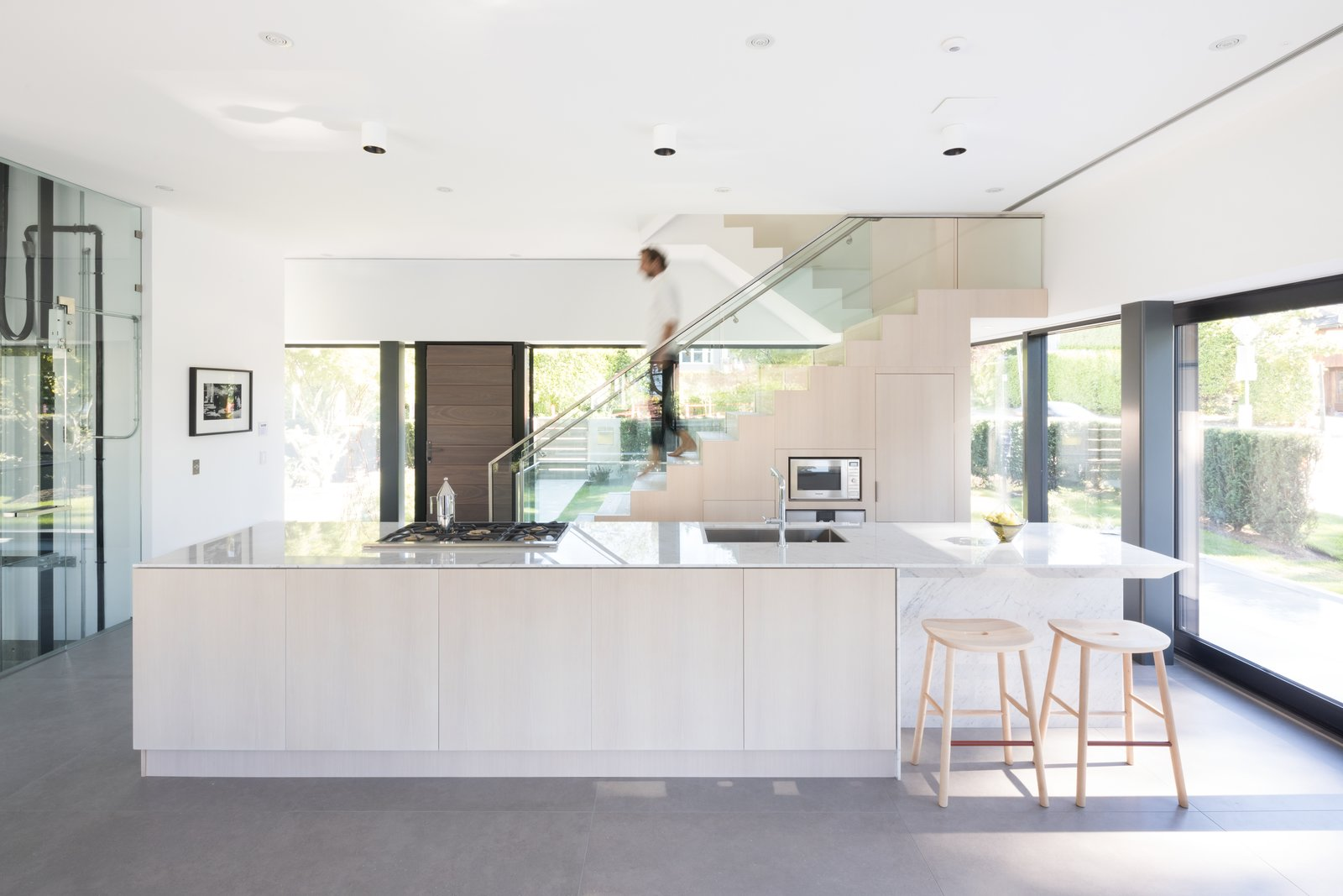 Tagged: Kitchen, Wood Cabinet, Marble Counter, Ceiling Lighting, Wall Oven, and Drop In Sink.  Photo 5 of 12 in Wrapped in Galvanized Steel, 'Cube House' in Vancouver Asks $12.8M
