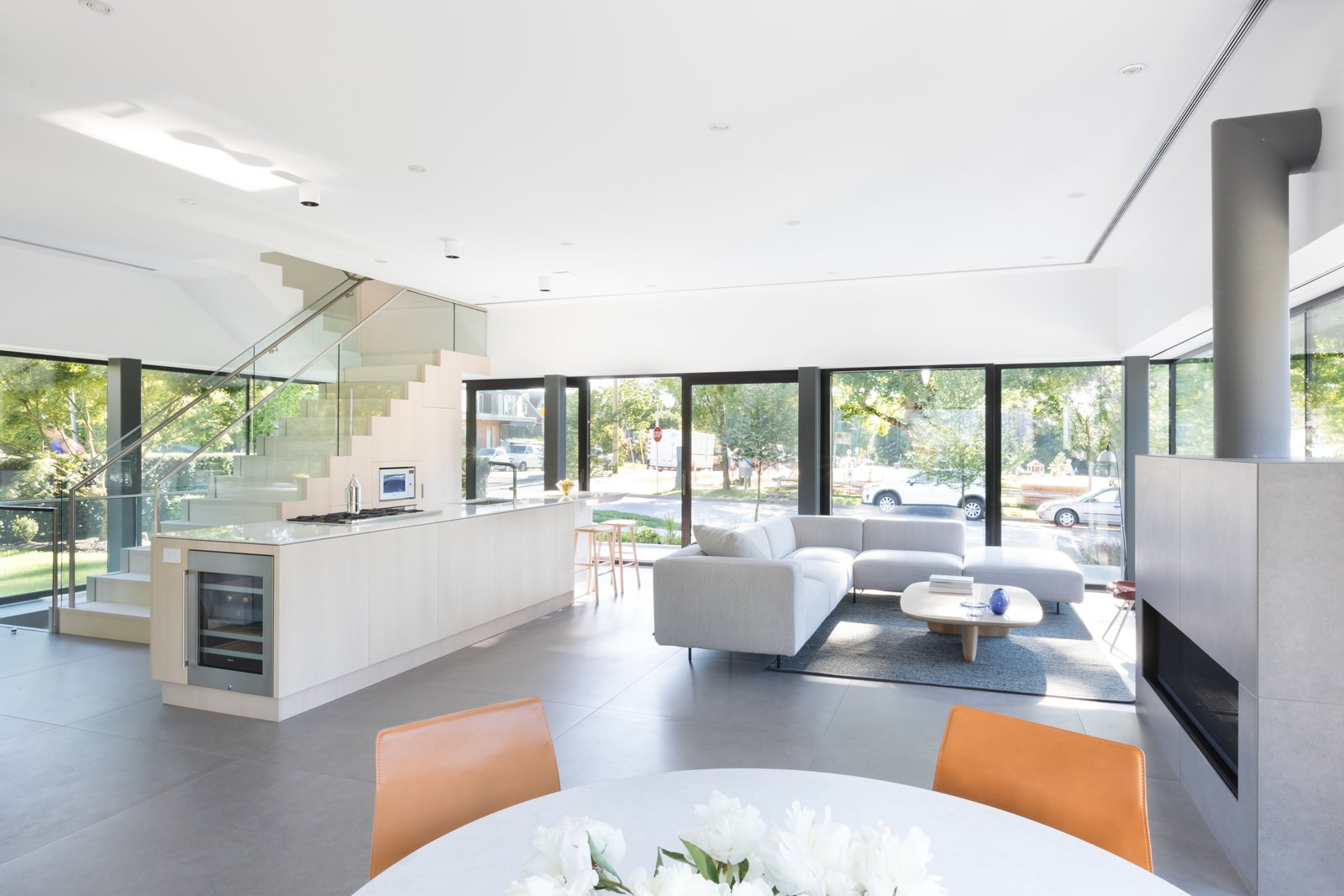 Tagged: Living Room, Stools, Coffee Tables, Gas Burning Fireplace, Ribbon Fireplace, Sectional, Rug Floor, Bar, Chair, Table, and Recessed Lighting.  Photo 3 of 12 in Wrapped in Galvanized Steel, 'Cube House' in Vancouver Asks $12.8M