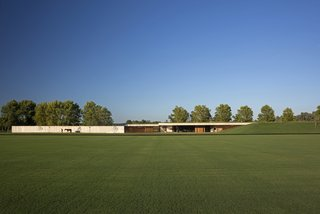 Celebrated Polo Player Nacho Figueras Commissions a Low-Slung, Concrete Stable - Photo 1 of 11 -