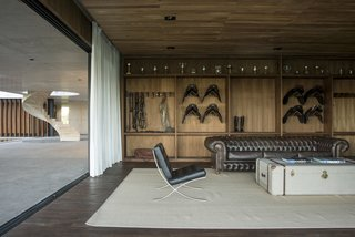 Celebrated Polo Player Nacho Figueras Commissions a Low-Slung, Concrete Stable - Photo 6 of 11 -