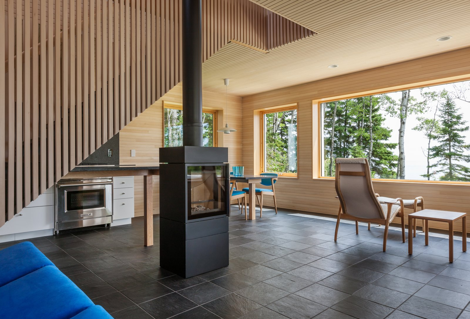 Tagged: Living, Recessed, Chair, End Tables, Sofa, Slate, Two-Sided, Pendant, and Ottomans.  Best Living Slate Two-Sided Photos from A Lake Superior Escape With a Whitewashed Masonry Sauna