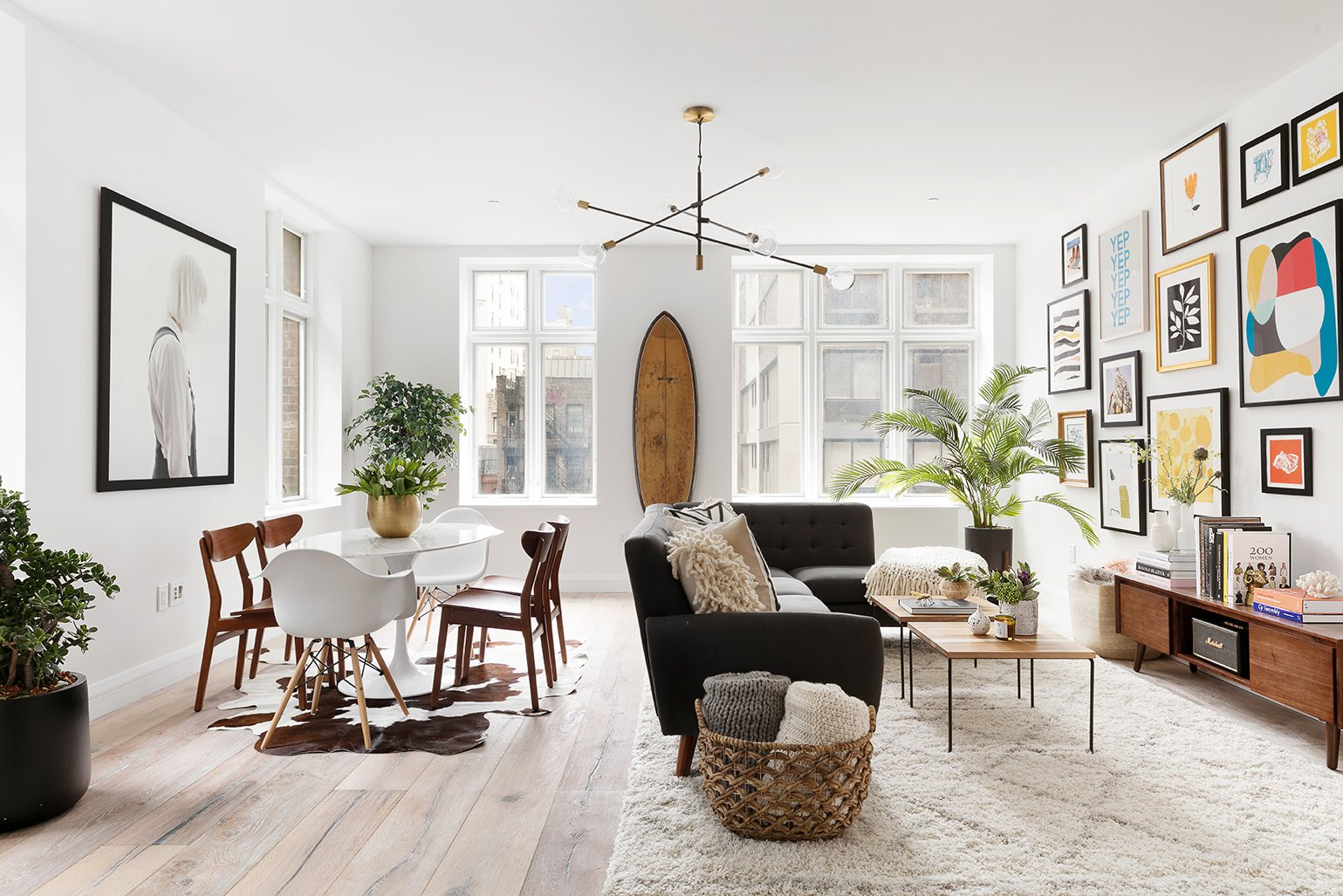Tagged: Living Room, Light Hardwood Floor, Rug Floor, Chair, Sectional, Coffee Tables, Storage, Media Cabinet, and Pendant Lighting.  Best Photos from This American Life's Ira Glass Lists His Light-Filled Chelsea Apartment For $1.75M