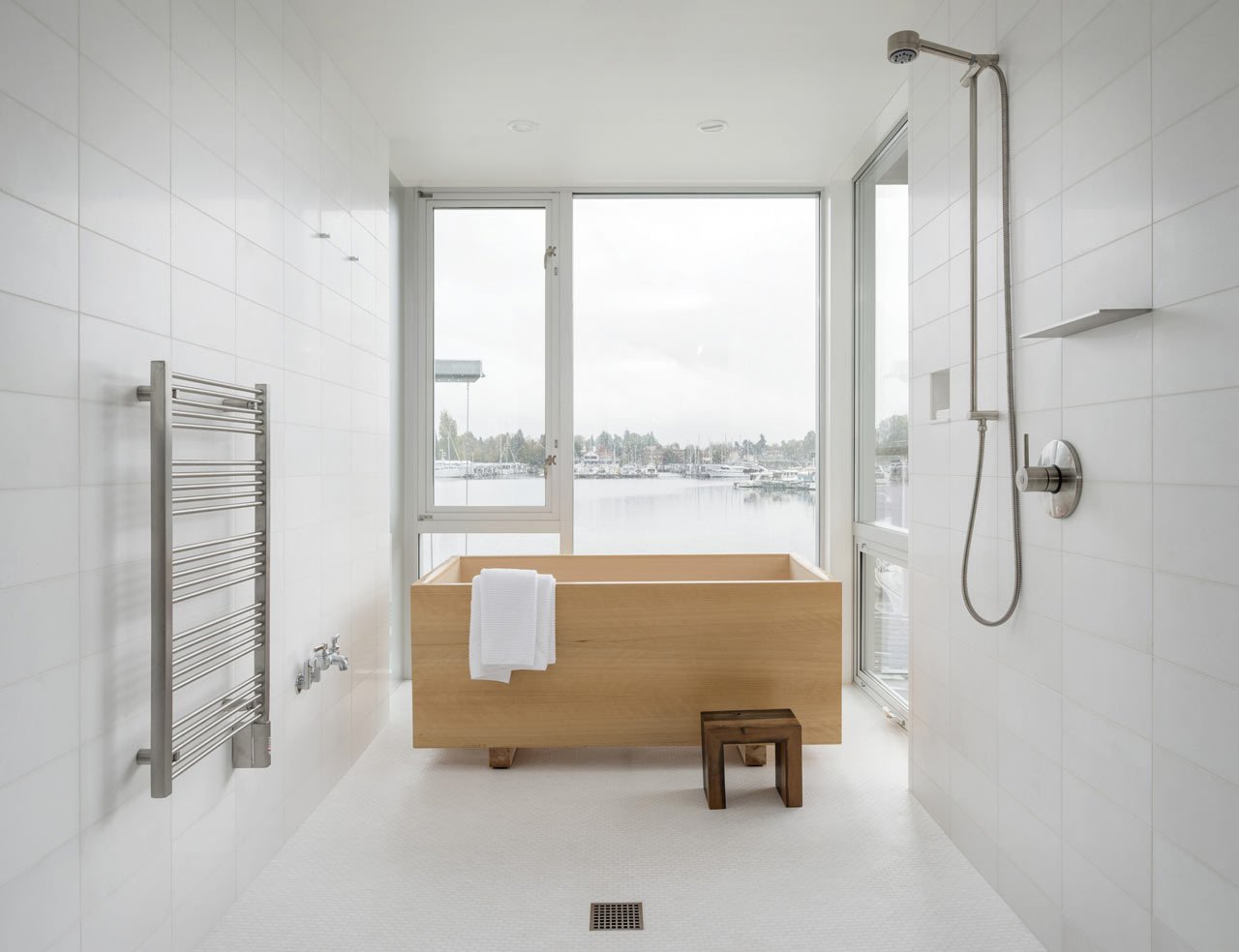 Overlooking Portage Bay in Seattle, this house was designed by Heliotrope Architects for a bachelor who longed for a simple bathroom with a Japanese-style hinoki tub that was installed in front of the windows for the water views.  Photo by Aaron Leitz  SHOWERS by J.P. Rutledge from 10 Minimalist Bathrooms of Our Dreams