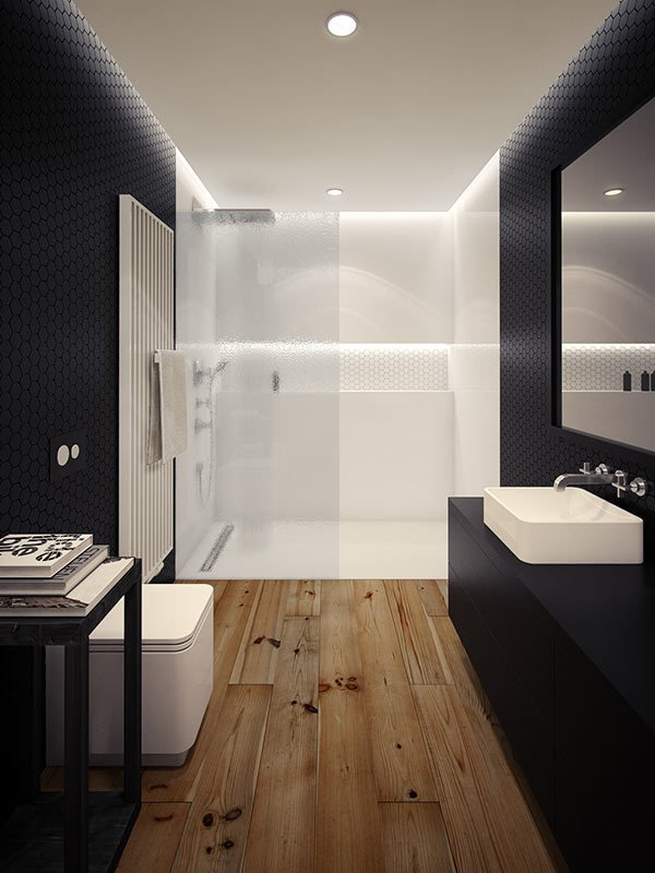 Architect and interior designer Oskar Firek created this black and white bathroom in a loft apartment in Krakow, Poland. Rustic wooden floors ground the black tile walls and cabinet, which contrast with the white shower and fixtures that round out the space.  Photo by Oskar Firek  SHOWERS by J.P. Rutledge from 10 Minimalist Bathrooms of Our Dreams