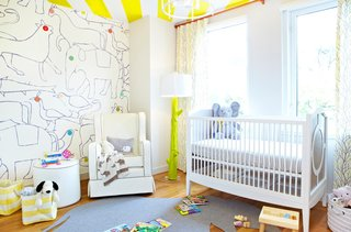 20 Cool Cribs for the Modern Baby - Photo 20 of 20 - The clients didn't know the sex of the baby so they chose decor that would work for either while still keeping it bright and colorful. One of the walls is covered with a Minikani Lab mural that sets the tone for the room.<br><br>Photo by Jacob Snavely
