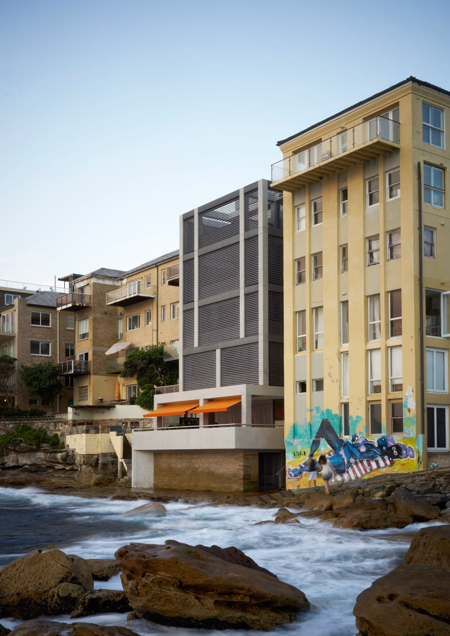 Spanning five levels, all of which vary in height, the house has balconies on each of the floors that project out to maximize the water views. The layout also allows the house to be separated into two different apartments if they have guests in town. #designmilk #bondibeach #tobiaspartners  A Dream-Worthy Beach House at Bondi Beach by Design Milk