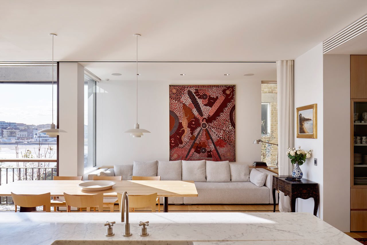 Throughout the house, paintings, sculptures, furniture, and heirlooms are thoughtfully displayed showing the family's history and travel memories. #designmilk #bondibeach #tobiaspartners