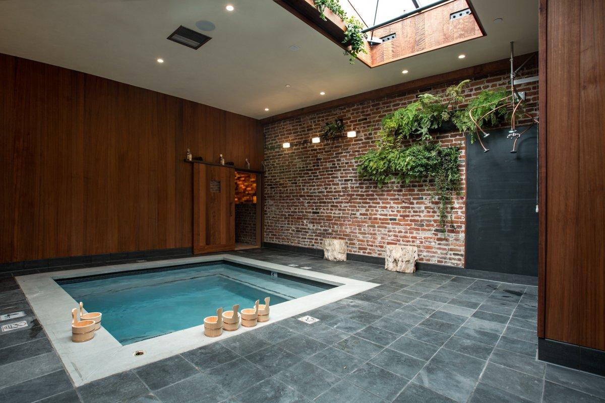Former Auto Body Shop Transformed Into Zen Bathhouse - Photo 2 of 14