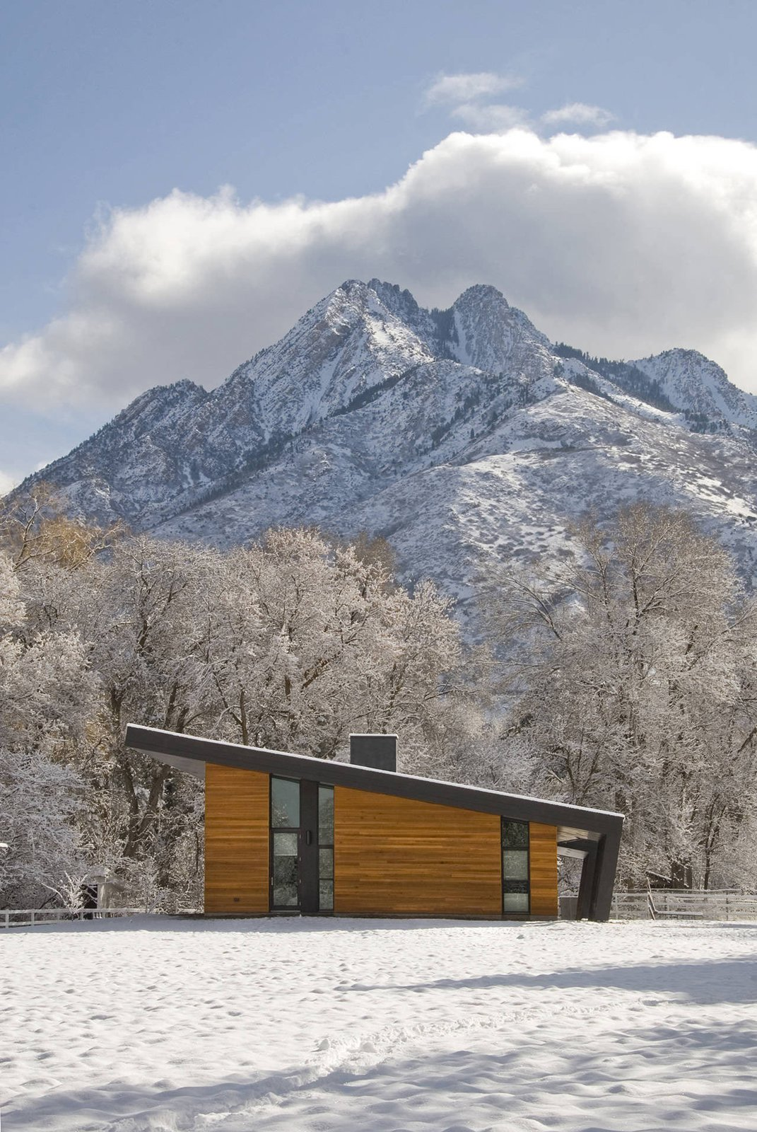 Pasture Project is built on a pasture in the shadows of Mt. Olympus in Holladay, Utah by Imbue Design. With a focus on using minimal energy, the home's living space is situated with a north/south orientation to aid in winter heat gain and summer protection.  Photo 10 of 11 in 10 Modern Wintry Cabins We'd Be Happy to Hole Up In