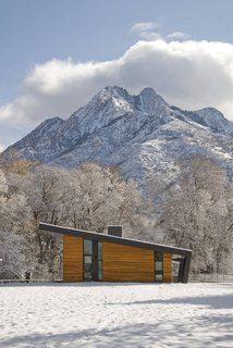 10 Modern Wintry Cabins We'd Be Happy to Hole Up In - Photo 9 of 10 - Pasture Project is built on a pasture in the shadows of Mt. Olympus in Holladay, Utah by Imbue Design. With a focus on using minimal energy, the home's living space is situated with a north/south orientation to aid in winter heat gain and summer protection.