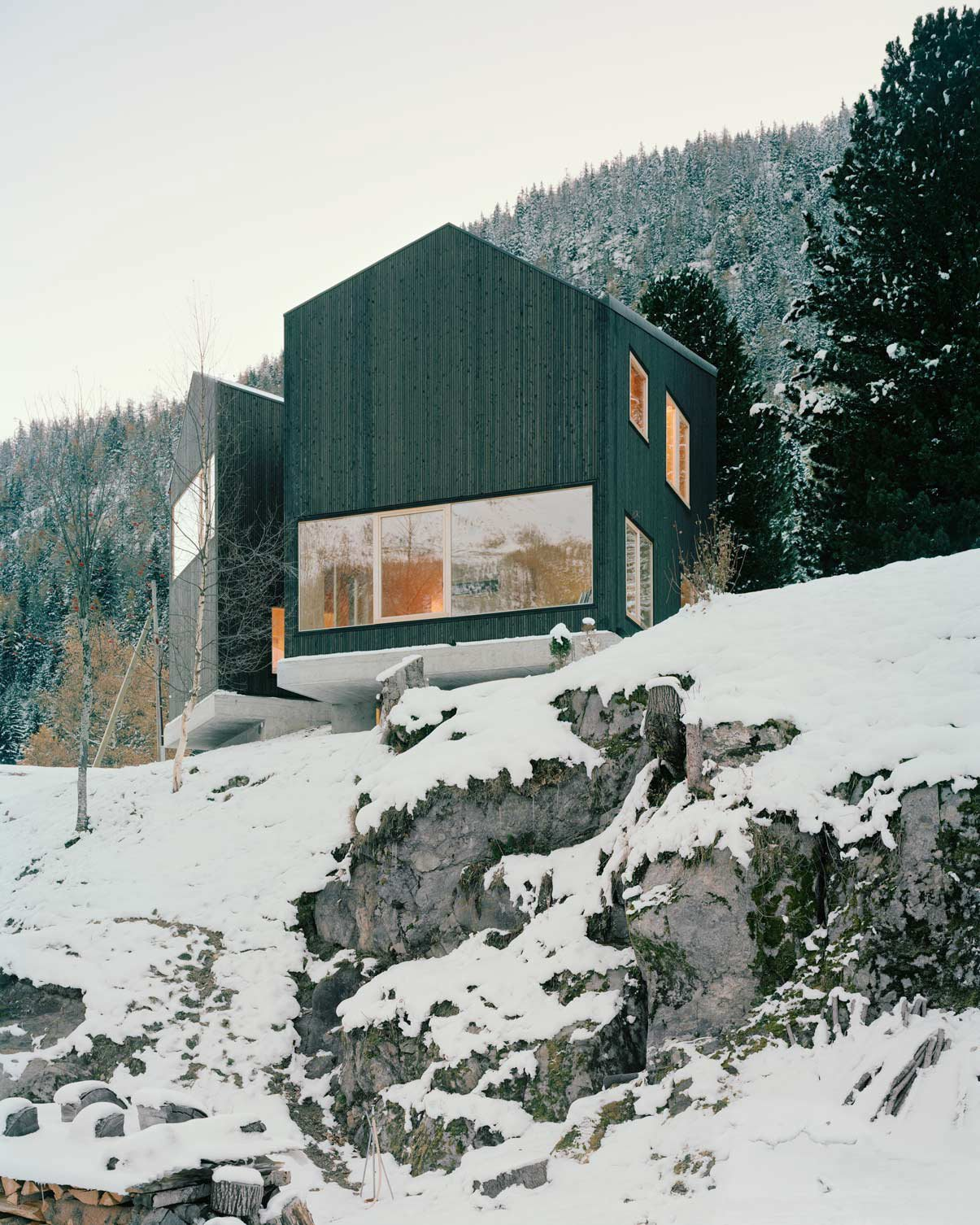 Lacroix Chessex Architectes realized La Maison aux Jeurs, a cabin in Les Jeurs, Switzerland situated on a rocky hill above the road. The structure is divided into two volumes that are angled 45 degrees apart with a connection on the mountain side. Both volumes are designed with different views of the valley below. Tagged: Exterior, Cabin Building Type, House, and Wood Siding Material.  Photo 11 of 11 in 10 Modern Wintry Cabins We'd Be Happy to Hole Up In