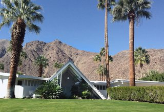 8 Iconic Houses in Palm Springs, California - Photo 6 of 8 - With a triangular A-frame front, similar to that of a Swiss ski chalet, the Swiss Miss houses were designed by Charles Dubois in a section with about 15 other homes just like it. The unusual front spans two-stories tall giving the home some dramatic curb appeal.