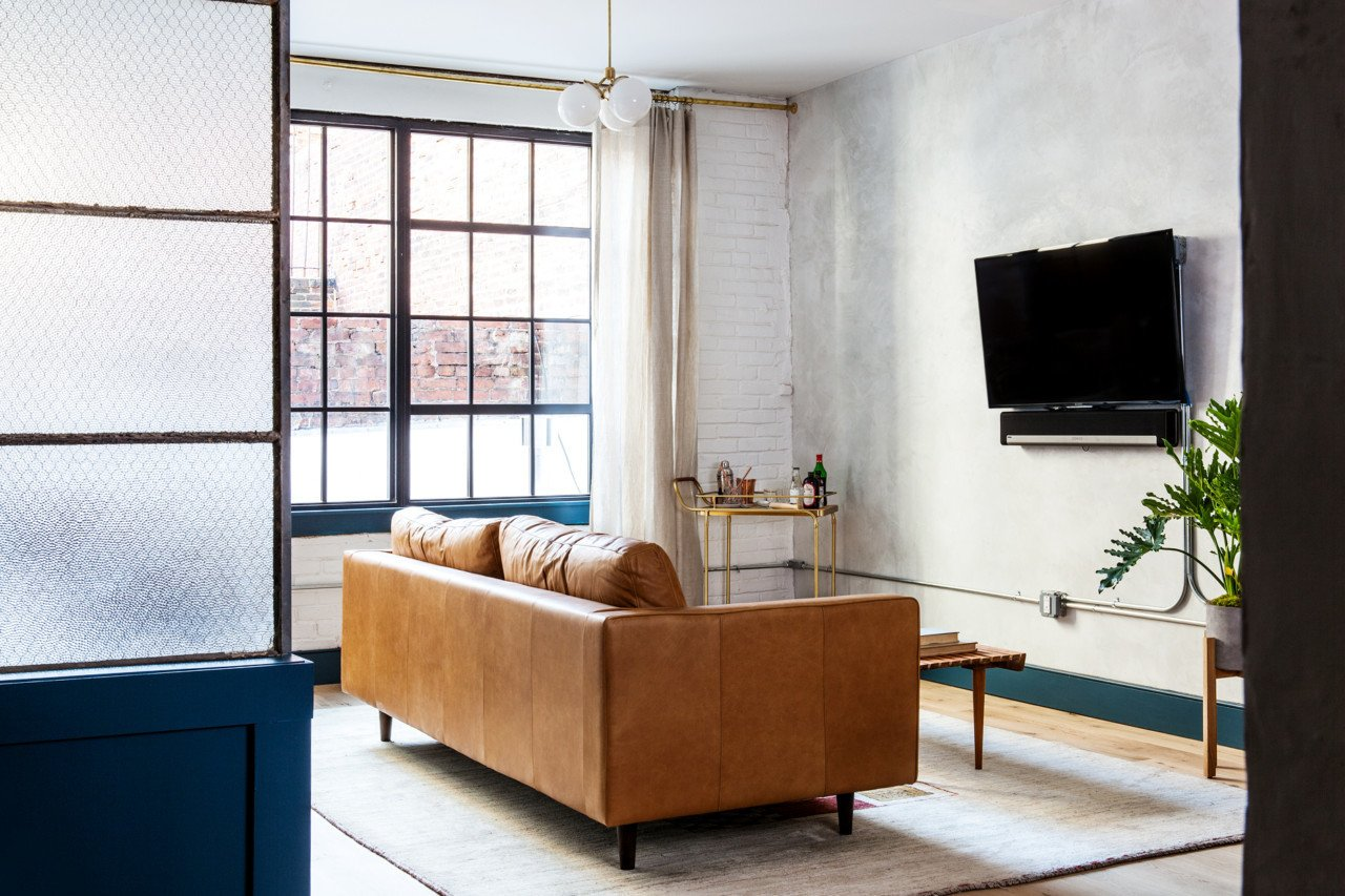 Tagged: Living Room, Coffee Tables, Sofa, Light Hardwood Floor, and Pendant Lighting.  Photo 16 of 18 in Lokal: A Classic Hotel with a Modern Invisible Service