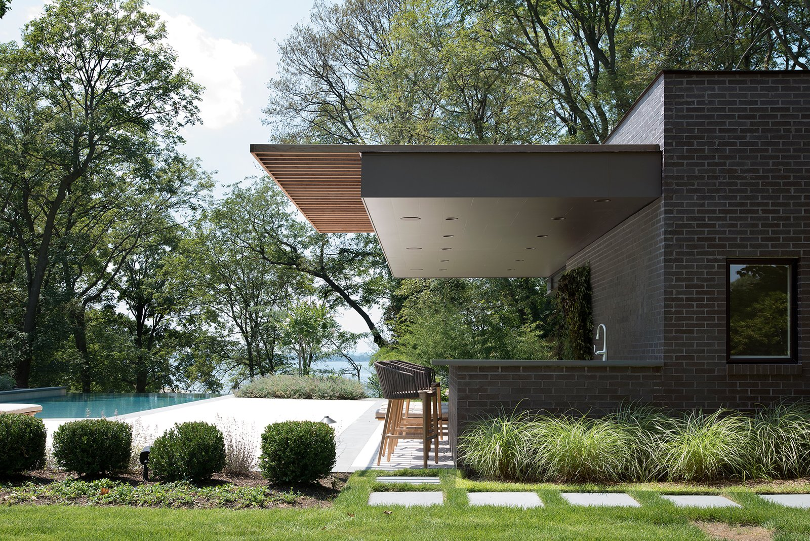 Located in Sands Point, New York, the Free Float Pool House by The UP Studio creates spaces for relaxing by the pool and entertaining with views to the Long Island Sound.