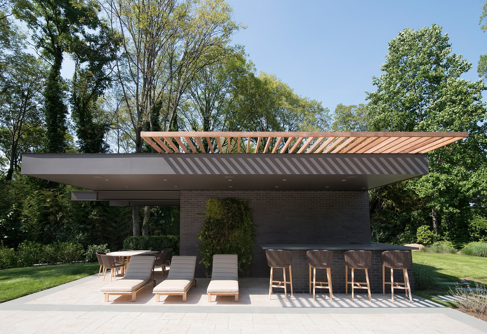 The Free Float Pool House's cantilevered steel creates a column-free shaded area. Free Float Pool Cabana by The UP Studio