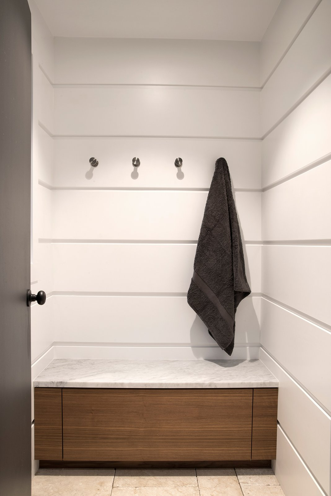 The Free Float Pool House's interior changing room features white wall panels with reveals for visual interest.