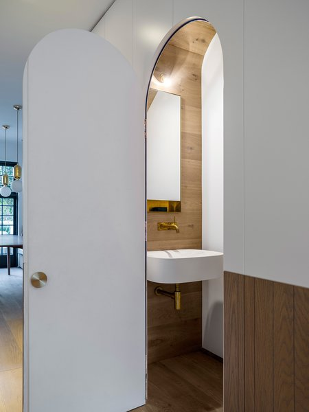Preparing for a commission to design the new Airbus toilets, Luigi Rosselli Architects have experimented with compact design for such situations with the understairs powder room. © Justin Alexander   Photo 10 of Bougainvillea Row House modern home