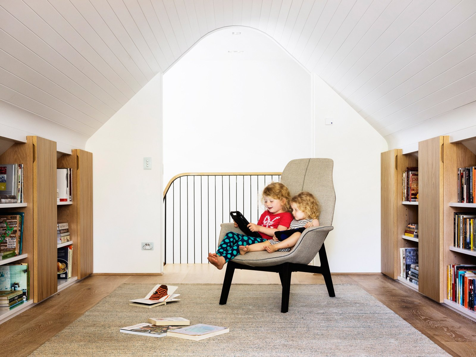 Initially, the attic room was going to be a study for the hard working parents but the girls appropriated it as their wet weather playroom. © Justin Alexander