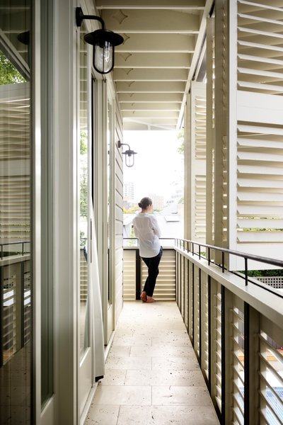 The loggia, or first floor covered balcony, is also a privacy screen that allows filtered air and light and obscures the neighbours' view. The shutters were masterfully constructed by the builder and Shutters Australia. Shutters Australia © Justin Alexander Photo 6 of Loggia in Arcadia modern home