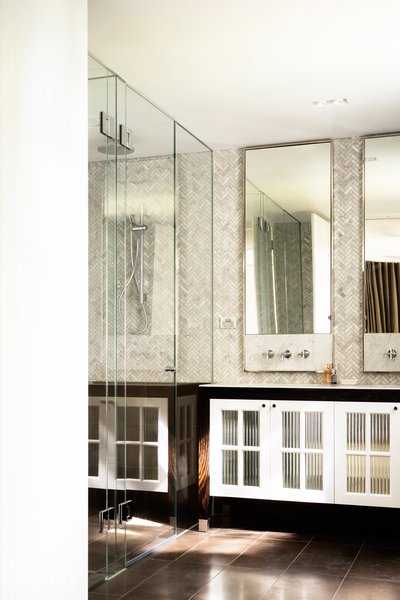 Nickel plated mirror frames, stone tap plates, herringbone marble mosaic, encaustic cement tiles form the texture rich palette of materials created by Romaine Alwill. Alwill Interiors © Justin Alexander Photo 10 of Loggia in Arcadia modern home