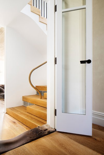 The original stone door sill that linked the front of the house to the back kitchen and Victorian outhouses. It links the new to the old, a new stair is visible in the background. © Justin Alexander Photo 11 of Loggia in Arcadia modern home