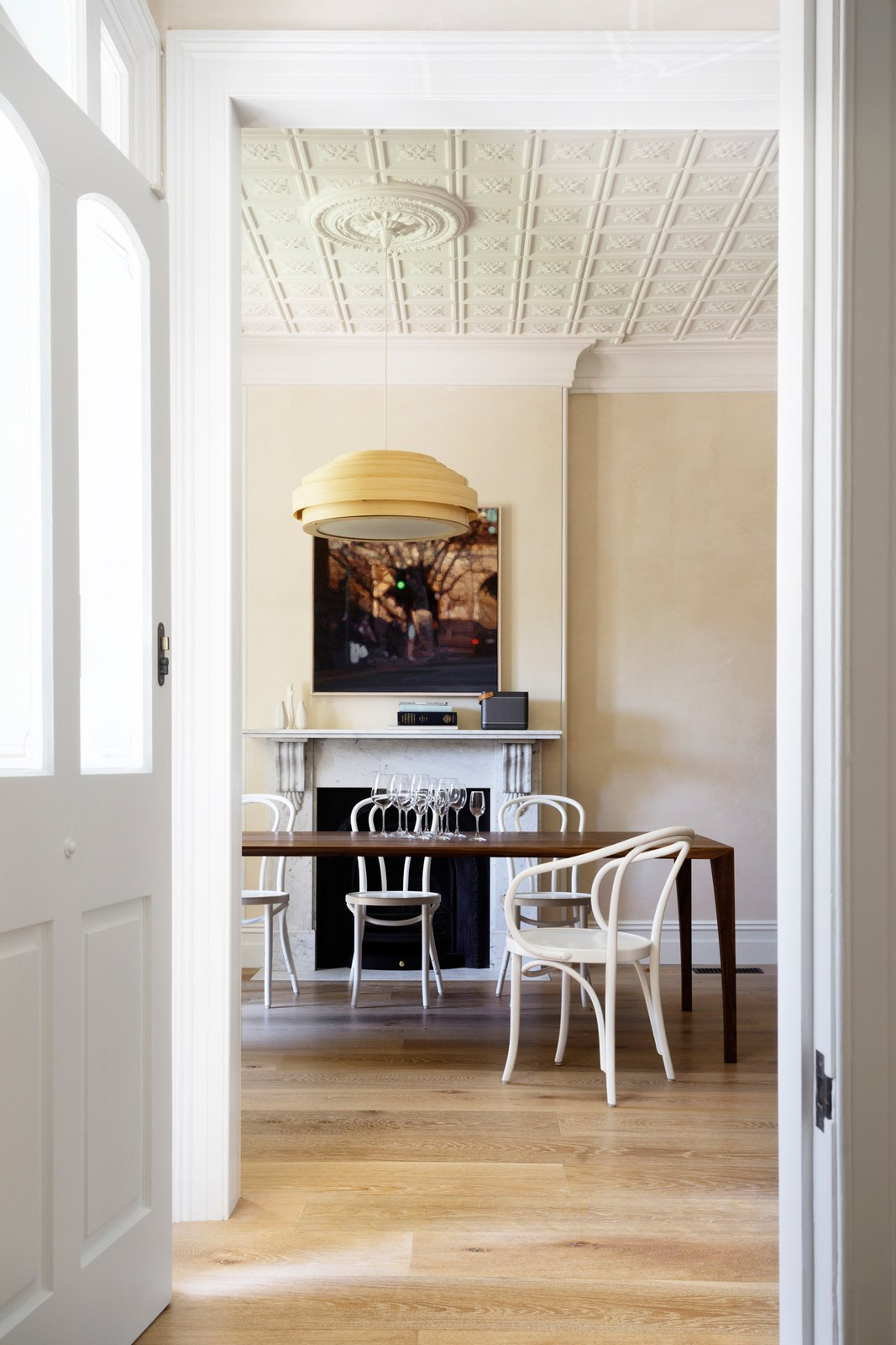 In the dining room the Carrara fire surround, waxed stucco lucido plaster walls and Thonet chairs all have one thing in common, they are all classics, classic materials, classic designs. © Justin Alexander