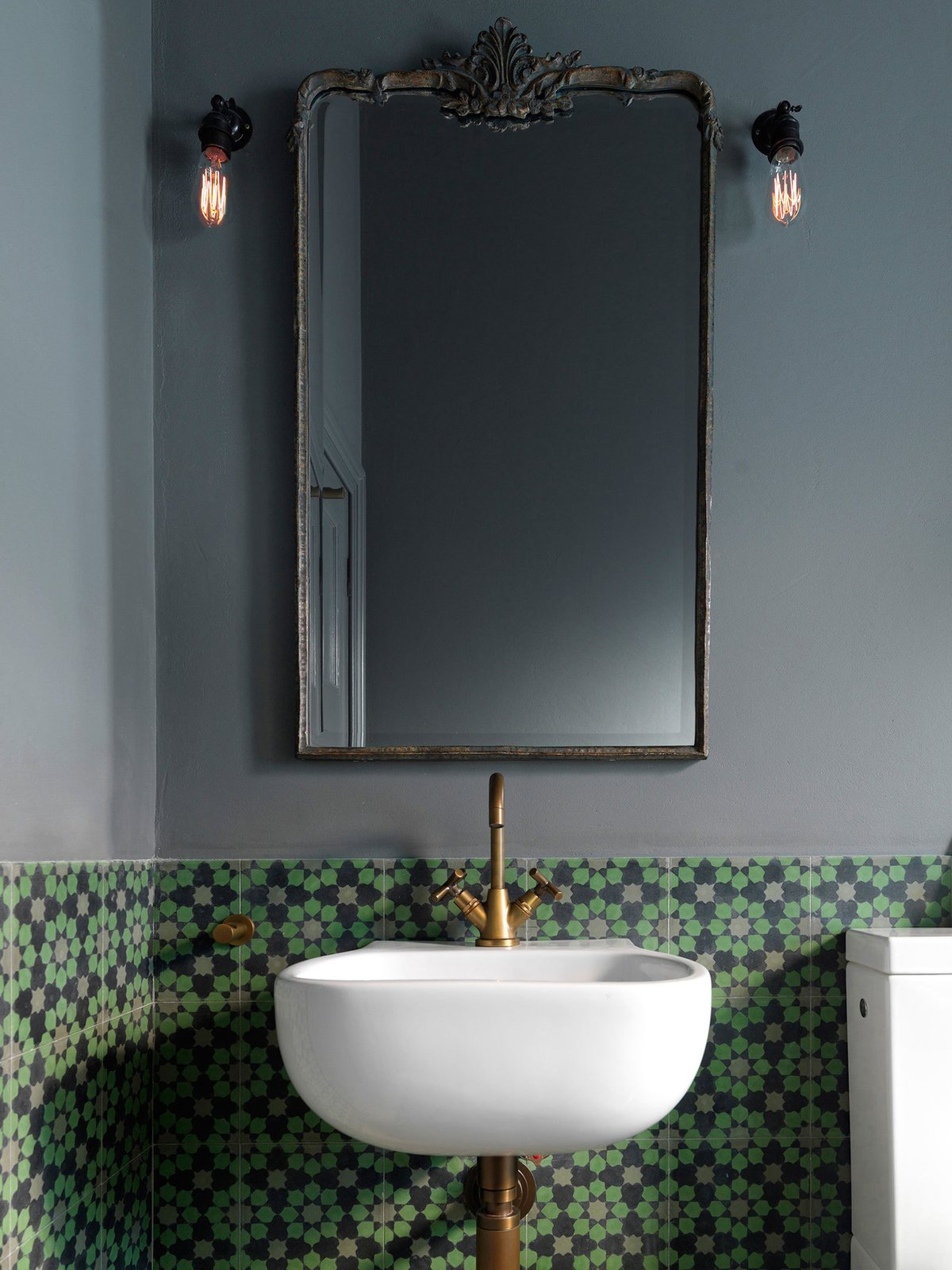 Bronze accents and handmade encaustic tiles from Europe. © Justin Alexander  The Pool House by Luigi Rosselli Architects