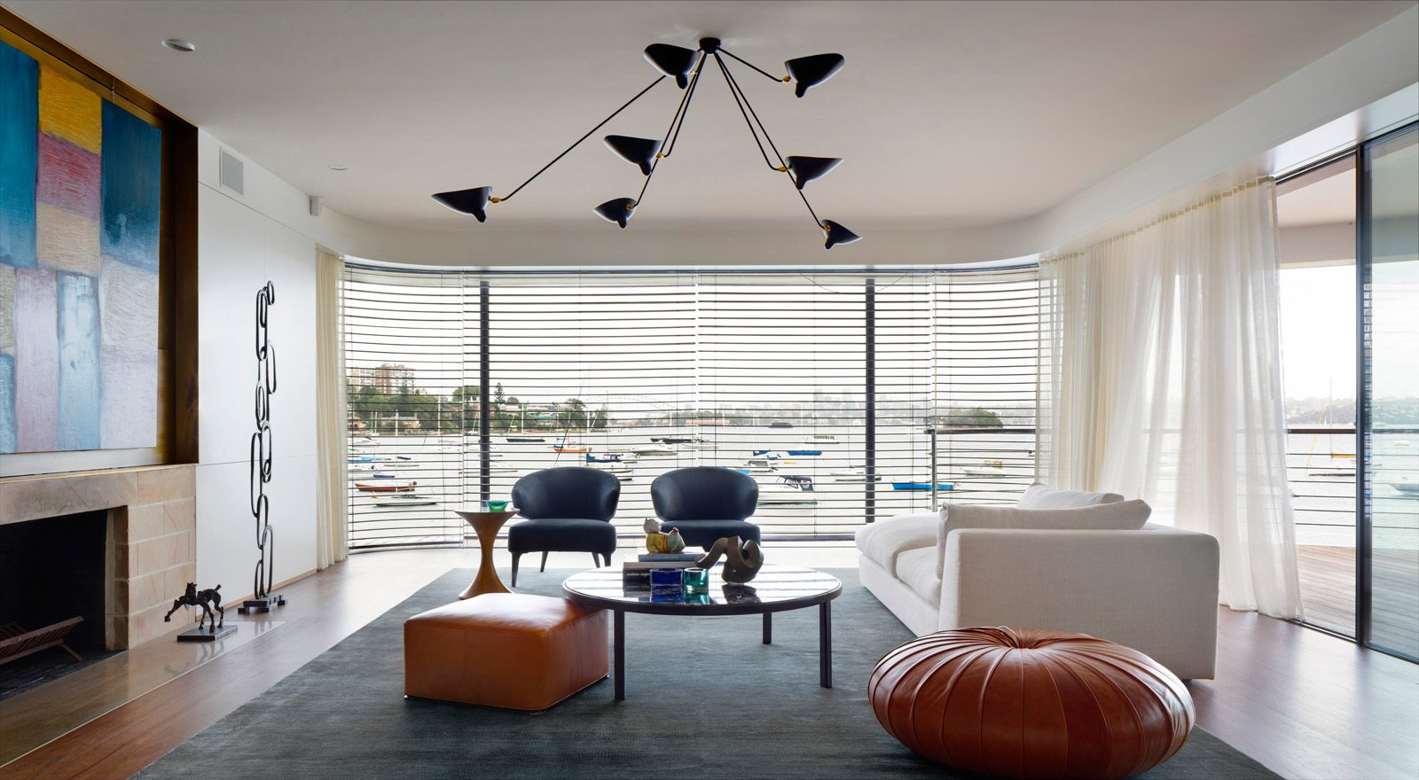 Nearly floating in Double Bay and Sydney Harbour, the living room is a collection of furniture classics, lighting icons and worldly artwork. © Justin Alexander  Harbour Front-Row Seat by Luigi Rosselli Architects