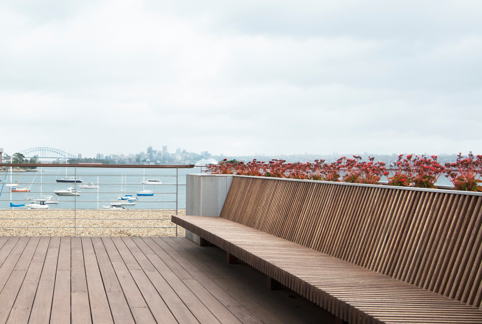 The seat made of hardwood decking board ready for the frequent fireworks over Sydney Harbour. © Edward Birch  Harbour Front-Row Seat by Luigi Rosselli Architects