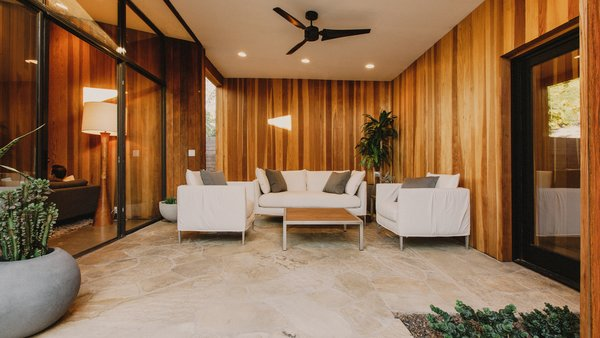 Modern home with outdoor, back yard, desert, raised planters, and stone patio, porch, deck. Breezeway between the living room and master suite Photo 6 of Curves House