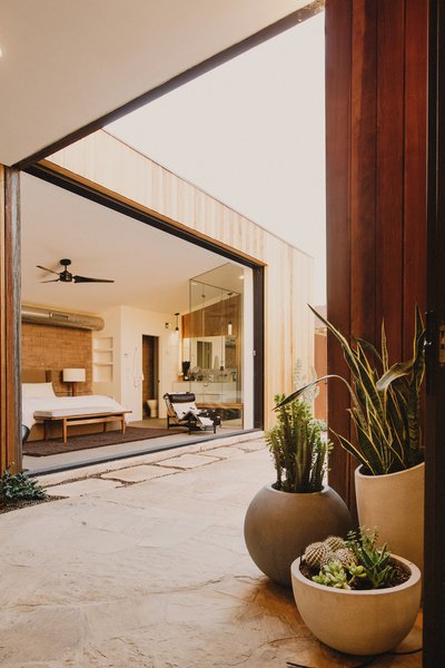 Breezeway to the master bedroom beyond that opens up to the pool courtyard through a pocketing glass door