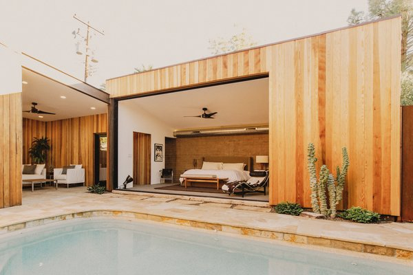 Modern home with outdoor, shrubs, back yard, salt water pool, stone patio, porch, deck, raised planters, desert, and small pool. Master suite and breezeway off of the pool courtyard Photo 12 of Curves House