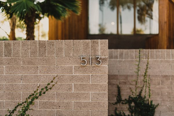 Modern home with outdoor, front yard, and desert. Entry wall Photo 7 of Curves House
