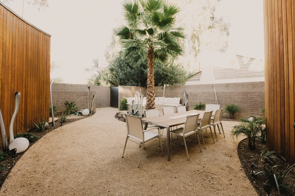 Modern home with outdoor, desert, shrubs, trees, decomposed granite patio, porch, deck, and stone patio, porch, deck. Front courtyard extends living functions outside of the house, allowing the house to live much larger than its footprint Photo 19 of Curves House