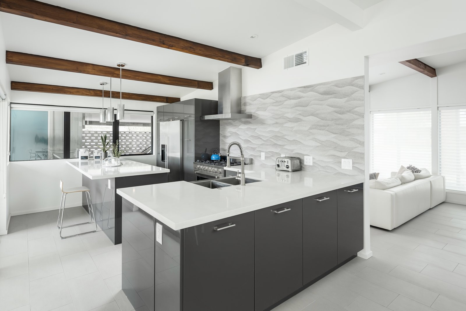 Kitchen Tagged: Kitchen, Engineered Quartz Counter, Porcelain Tile Floor, Porcelain Tile Backsplashe, Ceiling Lighting, Pendant Lighting, Range, Range Hood, Refrigerator, and Undermount Sink.  Schreiber House by The Ranch Mine