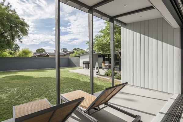 Modern home with outdoor, back yard, concrete patio, porch, deck, and grass. Master bedroom patio Photo 9 of Schreiber House