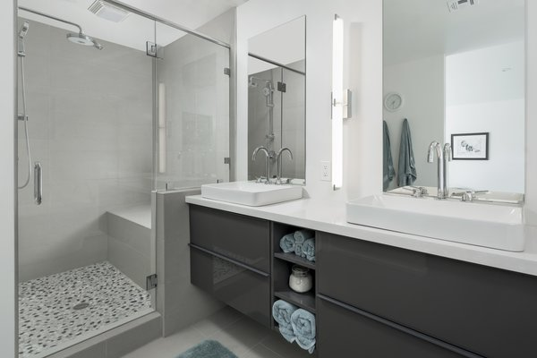 Modern home with bath room, engineered quartz counter, vessel sink, porcelain tile floor, freestanding tub, enclosed shower, porcelain tile wall, and two piece toilet. Master shower Photo 7 of Schreiber House