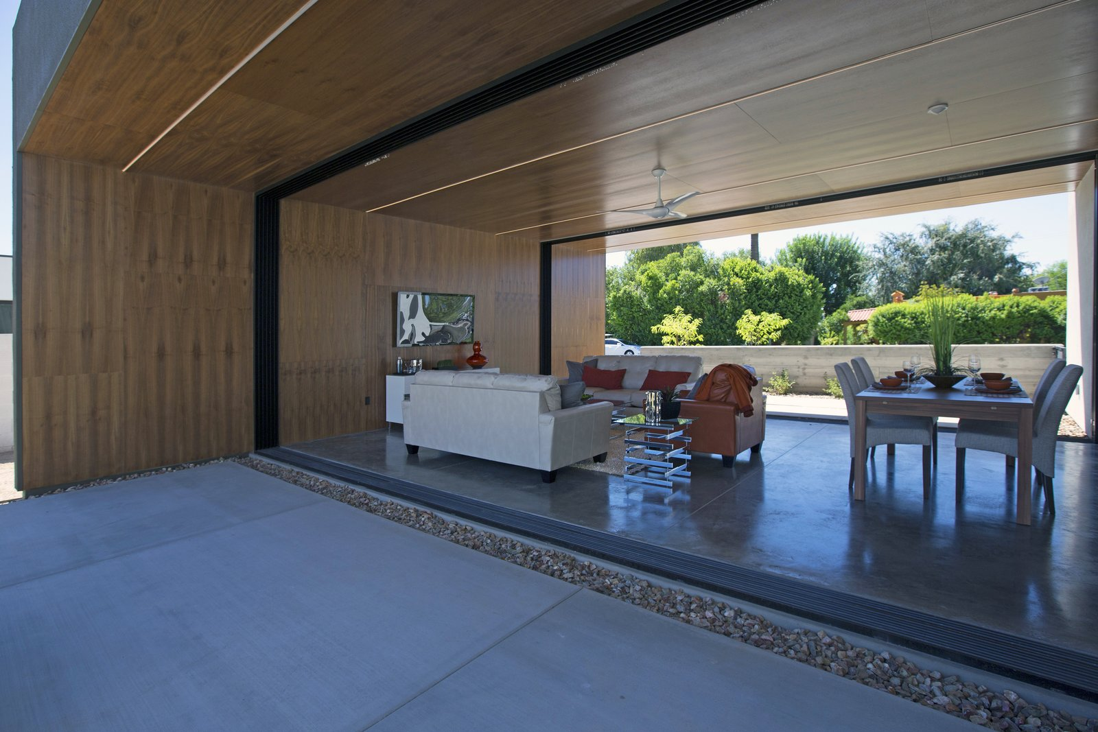 #modern #minimal #indooroutdoor #phoenix #arizona Tagged: Trees, Back Yard, Concrete Patio, Porch, Deck, Ceiling Lighting, Concrete Floor, Grass, and Living Room.  Best Photos from Glass Walls • Windows • Sliding Walls