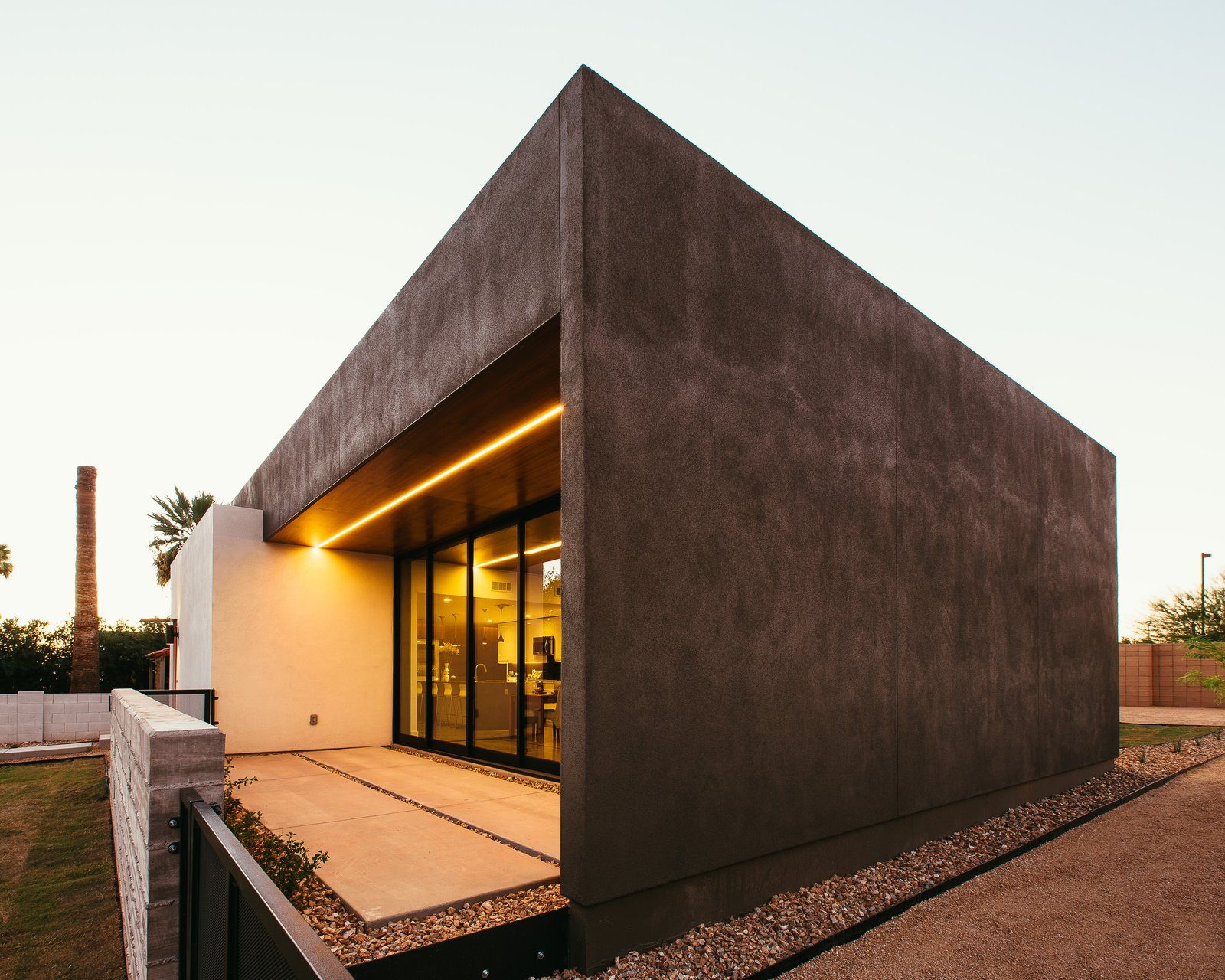 #modern #minimal #exterior #lighting #phoenix #arizona Tagged: Concrete Patio, Porch, Deck, Ceiling Lighting, Trees, Concrete Floor, Grass, Front Yard, and Outdoor.  Link House by The Ranch Mine