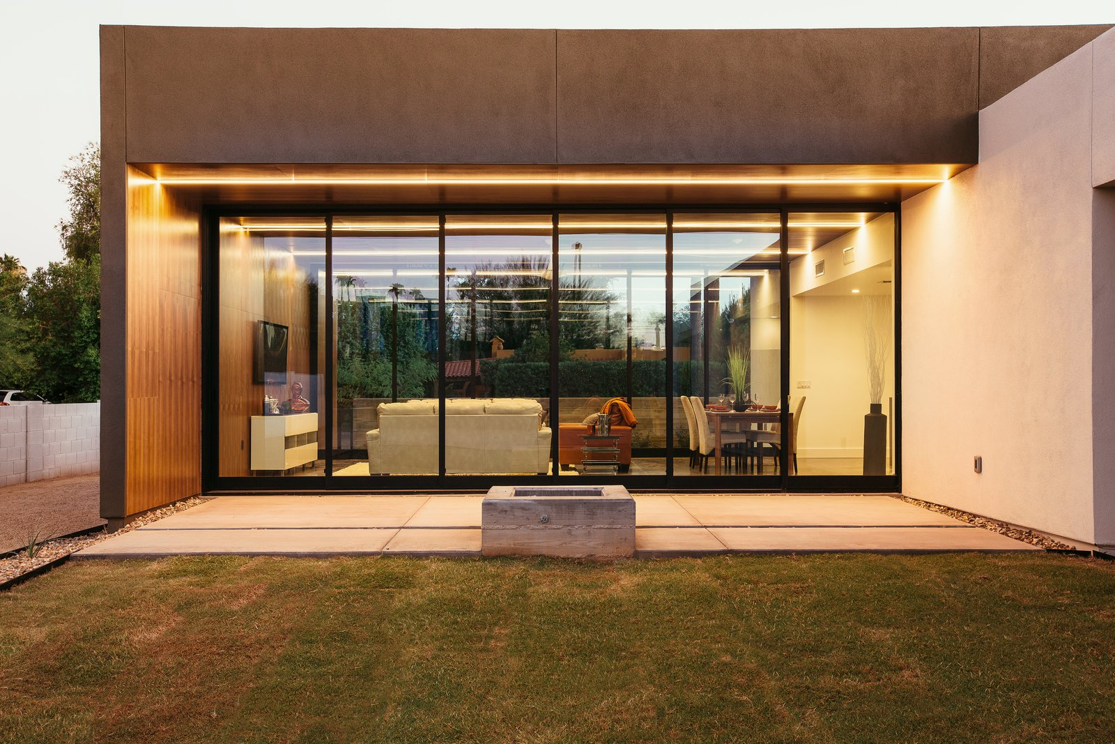 #modern #minimal #exterior #lighting #phoenix #arizona Tagged: Trees, Concrete Floor, Concrete Patio, Porch, Deck, Ceiling Lighting, Grass, White Cabinet, Engineered Quartz Counter, Undermount Sink, Open Shower, Ceramic Tile Wall, Back Yard, and Outdoor.  Link House by The Ranch Mine