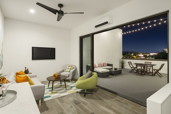 The 3rd story of the units has a wet bar and outdoor grill for the ultimate, urban indoor-outdoor living with views of the city and mountains beyond