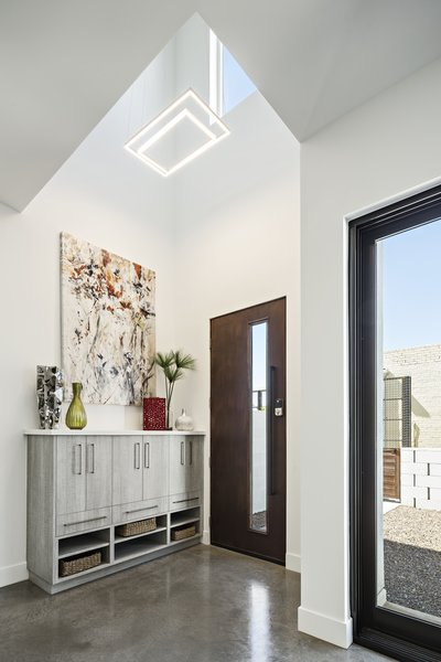 Modern home with hallway and concrete floor. Double height entry Photo 3 of Uptown Row