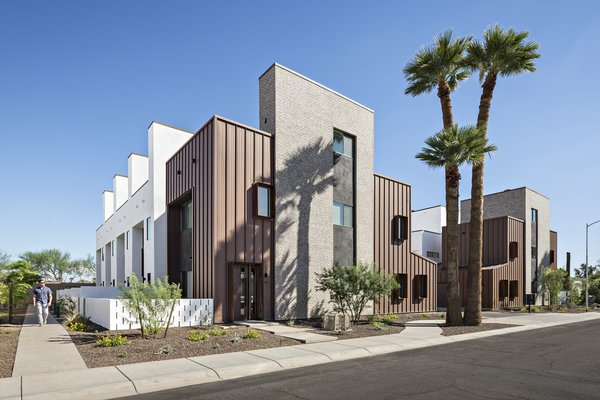 Uptown Row sits less than 1000 feet away from a light rail station in uptown Phoenix. This greyfield development adds 10, 3 story single-family attached homes, each with their own private courtyard and roof deck. #infill #development #townhouse #phoenix #modern #urban #wall #courtyard Photo 11 of Uptown Row modern home