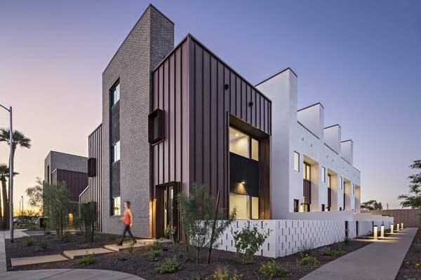 Uptown Row consists of 10 townhomes a mere 500 feet from a light rail station in Phoenix. Each unit has a semi-private courtyard behind a spaced block wall, and a private roof deck with view of the city skyline and mountains beyond #infill #development #townhouse  #phoenix #arizona#modern #urban #wall Photo  of Uptown Row modern home