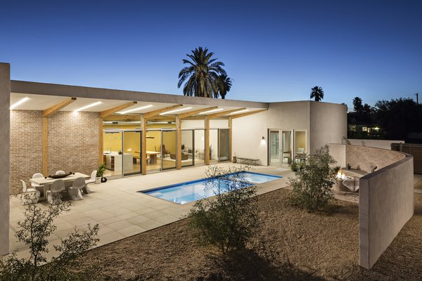 Modern home with outdoor, side yard, desert, small pool, and decomposed granite patio, porch, deck. Overall view of the courtyard that extends the livable area of the home Photo 17 of Sol House