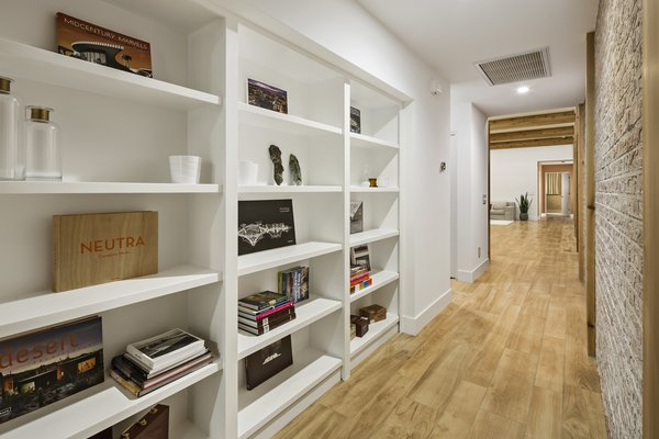 Modern home with storage room and shelves storage type. Hidden room behind a bookcase door Photo 14 of Sol House