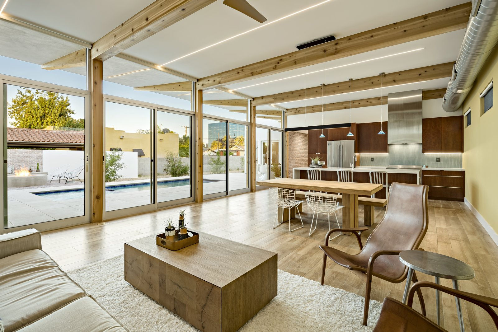 The focus of the great room was to connect with the outside patio. The sliding patio doors on the left and high windows on the right open up to create a nice cross breeze, cooling the house.