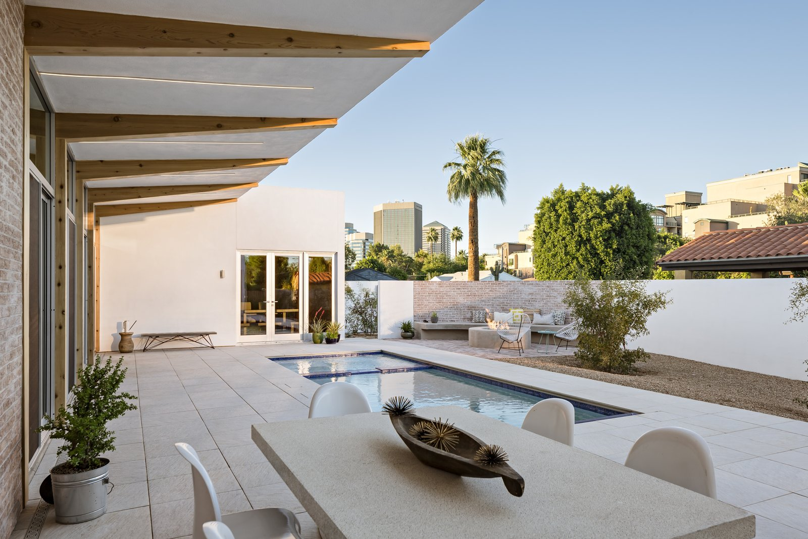 A 10 foot deep cantilevered roof provides consistent shade pool side in the courtyard