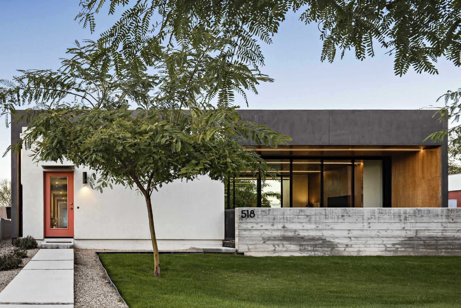 The front elevation is a modern distillation of the historic homes in the neighborhood, featuring the same composition of a protruded front volume with a single opening flanked by a shaded living area